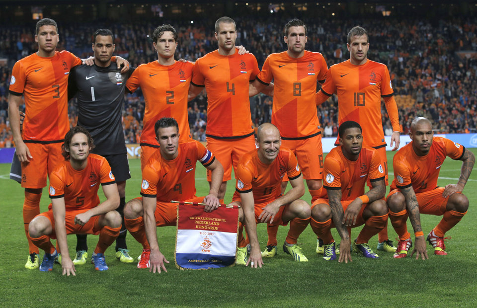 Photo - FILE - In this Oct. 11, 2013 file photo, Dutch soccer team poses prior the start the Group D World Cup qualifying soccer match between Netherlands and Hungary, at Arena stadium in Amsterdam, Netherlands. Background from left: Jeffrey Bruma, Michel Vorm, Daryl Janmaat, Ron Vlaar, Kevin Strootman, and Rafael van der Vaart. Foreground from left: Daley Blind, Robin van Persie, Arjen Robben, Jeremain Lens and Nigel de Jong.  (AP Photo/Peter Dejong, File)