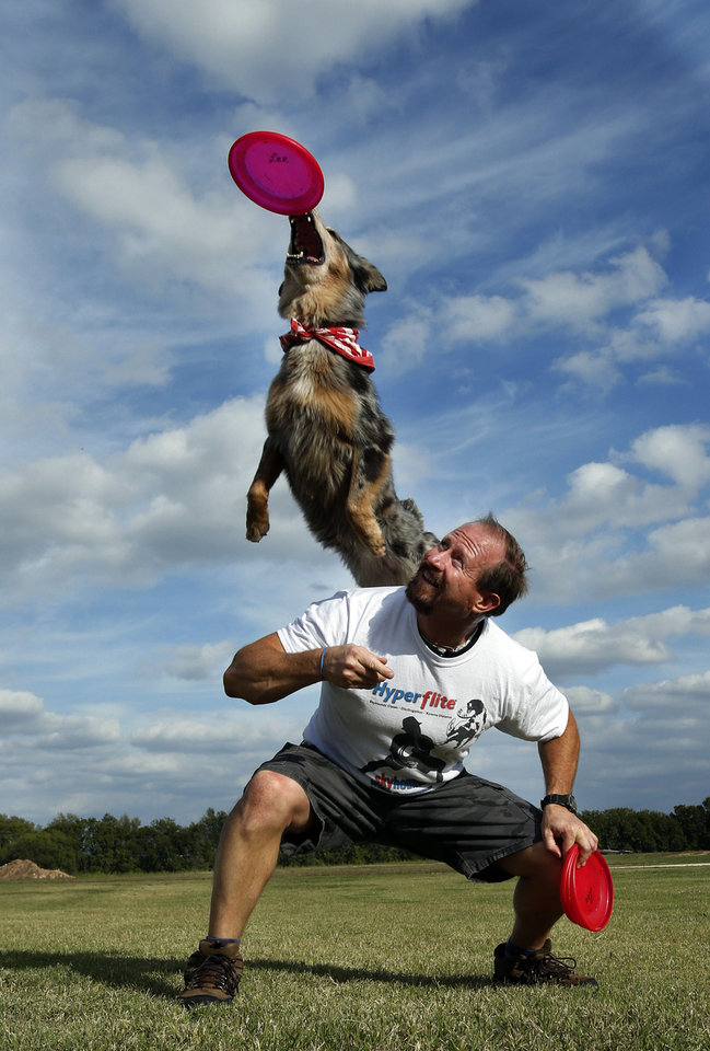 Lee Fairchild and his dog, Gracie, demonstrate their dog disc skills recently in Goldsby. Photo by Steve Sisney, The Oklahoman
