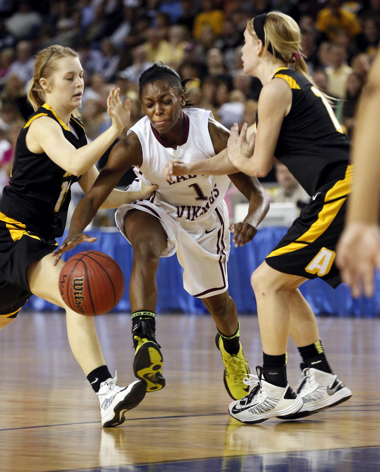 Northeast's Lanesia Williams splits defenders Kally Gordon, left, and Lora Riley during the 2A girls championship game between the Northeast Academy Lady Vikings and the Alva high school Lady Bugs at the State Fair Arena on Saturday, March 9, 2013 in Oklahoma City, Okla.  Photo by Steve Sisney, The Oklahoman