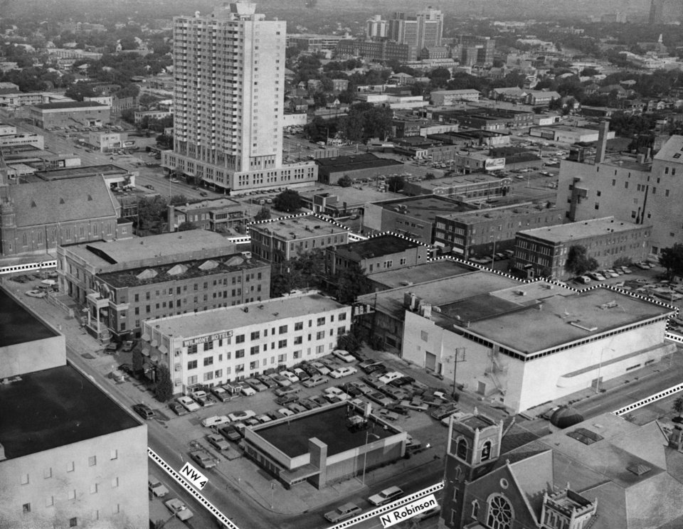 OKLAHOMA CITY / SKY LINE / OKLAHOMA / AERIAL VIEWS / AERIAL PHOTOGRAPHY / AIR VIEWS:  The outlined downtown block, bounded by NW 4, Harvey, NW 5 and Robinson is expected to be cleared by the end of the year for a new $13.2 million federal building.  Federal officials said demolition could begin as early as Sept. 15.  In this view looking northwest, the existing federal building is at the lower left corner.  Staff photo by Jim Argo.  Photo dated 08/29/1974 and published on 09/02/1974 in The Oklahoma City Times (No. Cen. A)