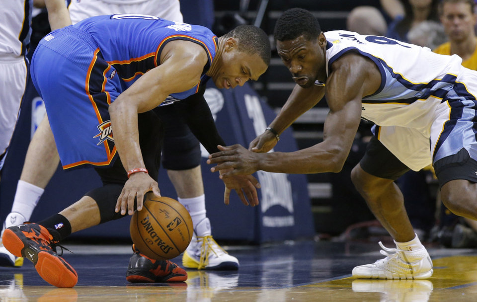 Photo - Oklahoma City's Russell Westbrook (0) reaches for a loose ball beside Memphis' Tony Allen (9) during Game 6  in the first round of the NBA playoffs between the Oklahoma City Thunder and the Memphis Grizzlies at FedExForum in Memphis, Tenn., Thursday, May 1, 2014. Oklahoma City won 104-84. Photo by Bryan Terry, The Oklahoman
