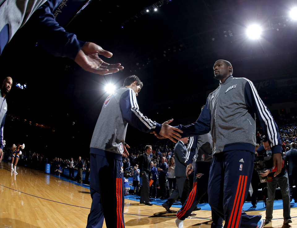 Photo - Oklahoma City's Kevin Durant is introduced before an NBA basketball game between the Oklahoma City Thunder and The Milwaukee Bucks at Chesapeake Energy Arena in Oklahoma City, Saturday, Jan. 11, 2014.  Oklahoma City won 101-85. Photo by Bryan Terry, The Oklahoman