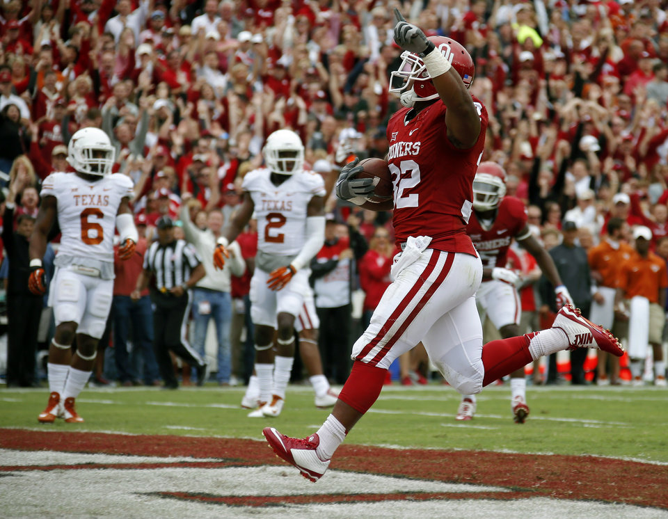 Photo - Oklahoma's Samaje Perine (32) scores a touchdown as Texas' Quandre Diggs (6) and Mykkele Thompson (2) watch during the Red River Showdown college football game between the University of Oklahoma Sooners (OU) and the University of Texas Longhorns (UT) at the Cotton Bowl in Dallas on Saturday, Oct. 11, 2014. 