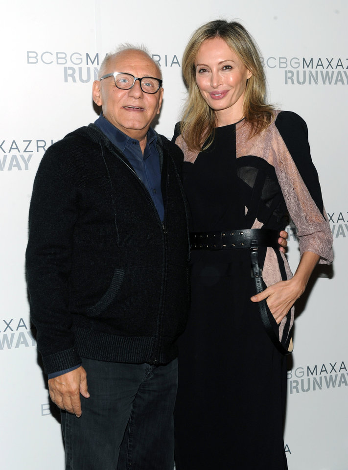 Photo -   Designers Max, left, and Lubov Azria pose together before the BCBG MAX AZRIA Spring 2013 collection is shown at Fashion Week in New York, Thursday, Sept. 6, 2012. (Photo by Diane Bondareff/Invision/AP Images)