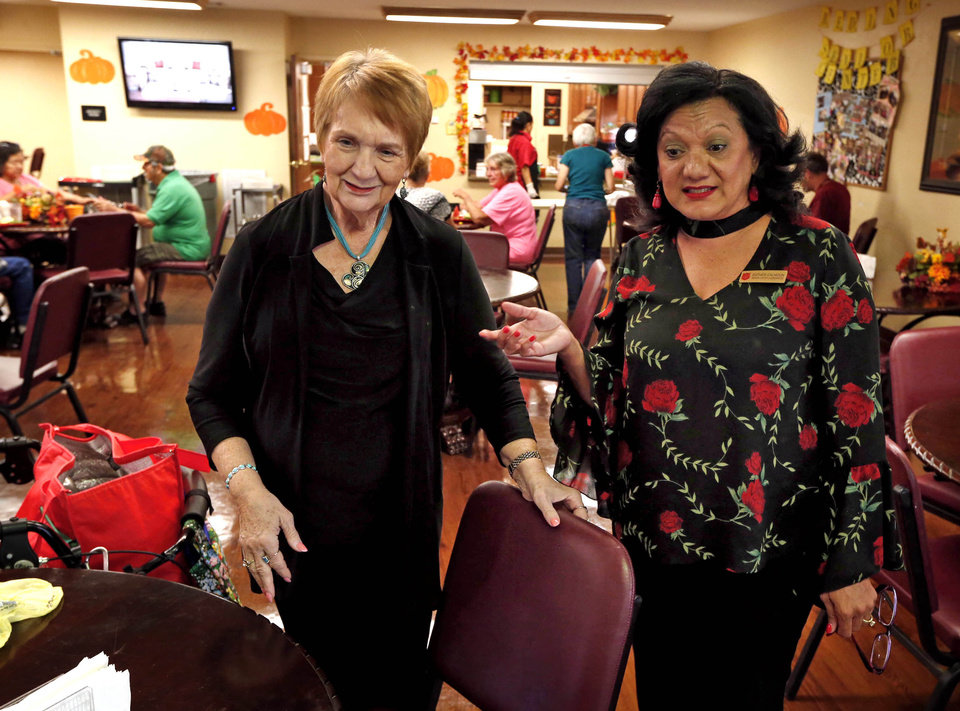 Photo -  The Salvation Army's Lisa Sydnor, left, and Esther Calhoun, work with older adults to gauge their needs. [PHOTO BY STEVE SISNEY, THE OKLAHOMAN ARCHIVES]