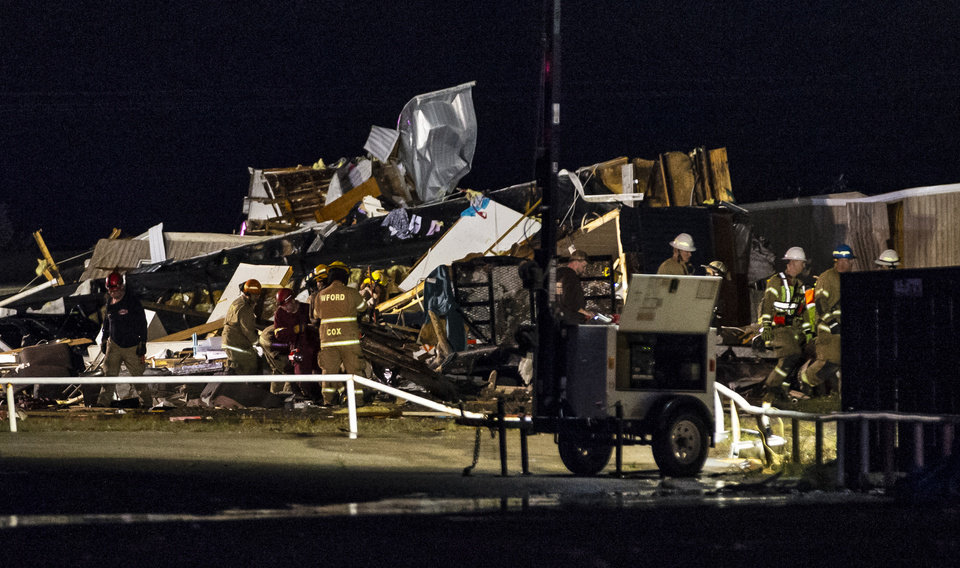 Photo - Crews work the scene where a tornado hit  the American Budget Value Inn in El Reno, Okla. on Sunday, May 26, 2019.  [Chris Landsberger/The Oklahoman]