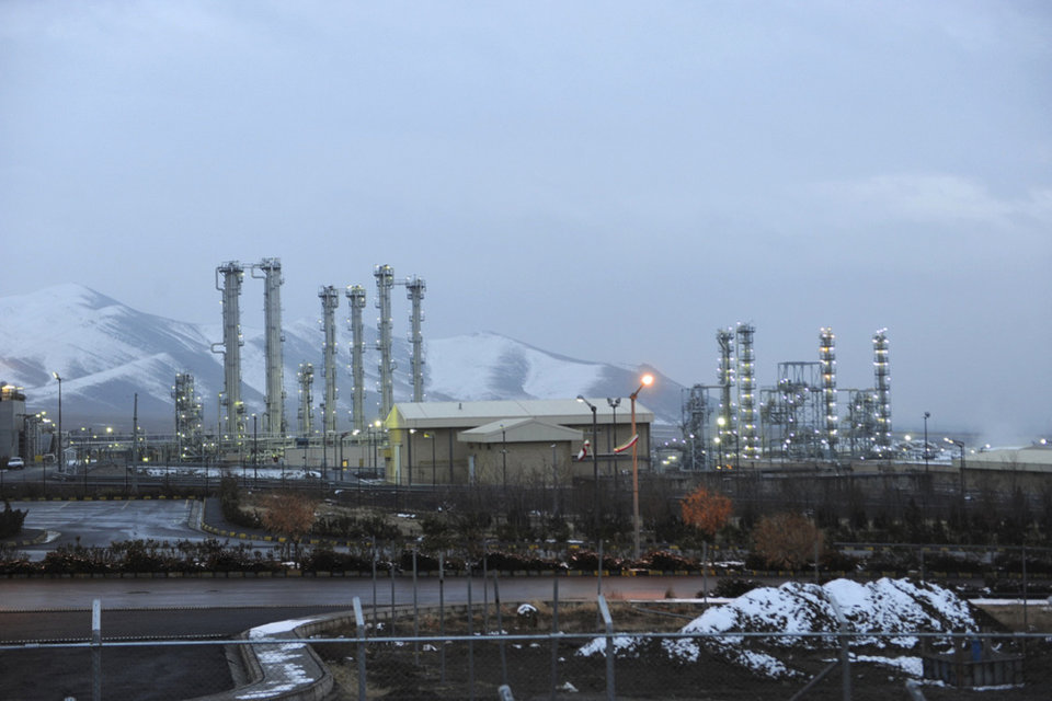 Photo - FILE--In this Jan. 15, 2011 file photo, Iran's heavy water nuclear facility near the central city of Arak is backdropped by mountains. Iran's reformers and moderate conservatives welcomed an agreement between Iran and six world powers on how to implement a nuclear deal struck in November, saying it will shore up Iran's sanctions-hit economy but hardliners still remain opposed. The six-nation group - the five permanent members of the U.N. Security Council plus Germany - and Iran have agreed to start implementing the terms of the historic interim deal from Jan. 20. That will start a six-month clock for a final deal to be struck over the Islamic Republic's contested nuclear program. (AP Photo/ISNA, Hamid Foroutan, File)