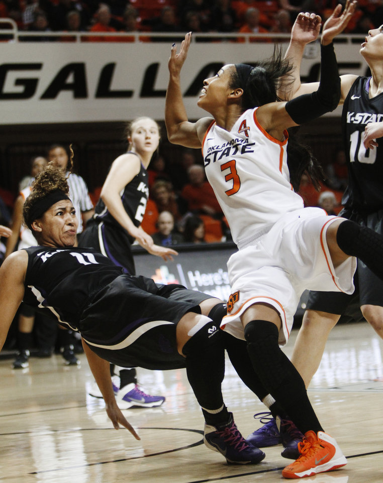 Photo - Oklahoma State's Tiffany Bias (3) collides with Kansas State's Chantay Caron (11) during an NCAA girl's college basketball game between Oklahoma State University (OSU) and Kansas State at Gallagher-Iba Arena in Stillwater, Okla., Saturday, March 1, 2014. Oklahoma State defeated Kansas State in 67-62 with Bias leading Oklahoma State at 17 points on her final game in Stillwater. Photo by KT King, The Oklahoman