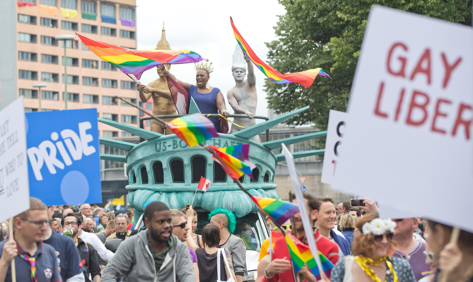 Photo - Participants of the Christopher Street Day parade through Berlin, Saturday June 21, 2014, with a float depicting the Statue of Liberty. The Obama administration has taken the U.S. gay rights revolution global, using American embassies across the world as outposts in a struggle that still hasn't been won at home. Sometimes U.S. advice and encouragement is condemned as unacceptable meddling. And sometimes it can seem to backfire, increasing the pressure on those it is meant to help.(AP Photo/dpa, Joerg Carstensen)  GERMANY OUT  AUSTRIA OUT  SWITZERLAND OUT