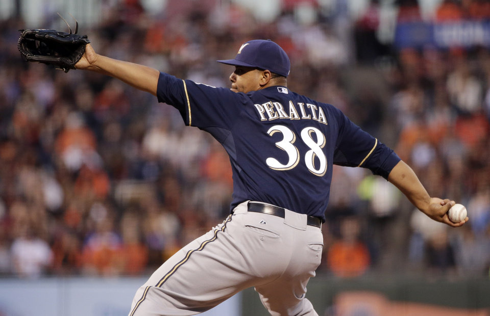 Photo - Milwaukee Brewers starting pitcher Wily Peralta throws to the San Francisco Giants during the first inning of a baseball game on Friday, Aug. 29, 2014, in San Francisco. (AP Photo/Marcio Jose Sanchez)