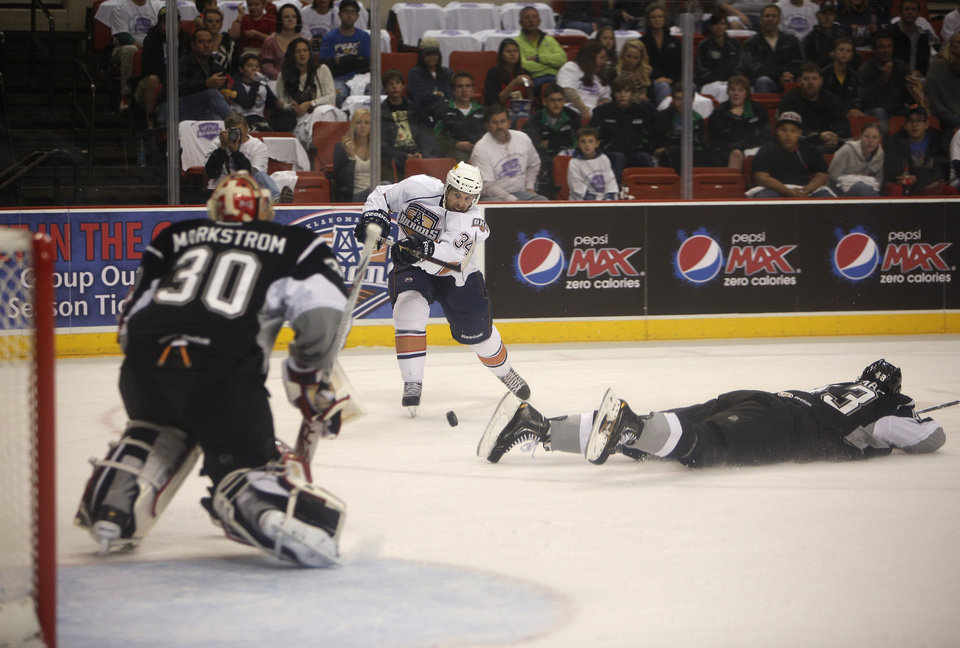 Photo - Oklahoma City's Dane Byers (34) takes a shot against San Antonio goalie, Jacob Markstrom (30, during a game between the Oklahoma City Barons and the San Antonio Rampage at the Cox Convention Center in Oklahoma City, Friday, Oct. 19, 2012.  Photo by Garett Fisbeck, The Oklahoman