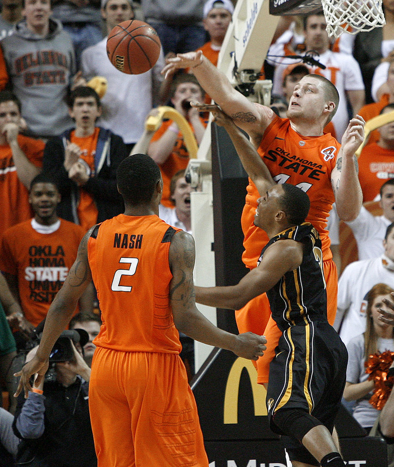 Oklahoma State's Philip Jurick (44) blocks the shot of Missouri's Matt Pressey (3) as Le'Bryan Nash (2) watches during an NCAA college basketball game between the Oklahoma State University Cowboys (OSU) and the Missouri Tigers (MU) at Gallagher-Iba Arena in Stillwater, Okla., Wednesday, Jan. 25, 2012. Photo by Bryan Terry, The Oklahoman
