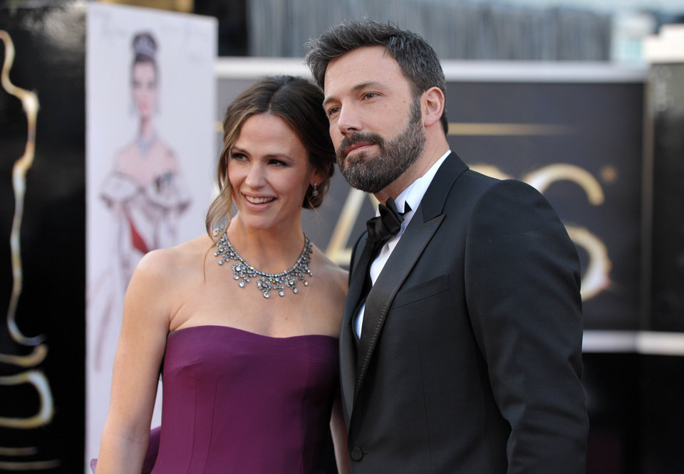 Photo - Actors Jennifer Garner, left, and Ben Affleck arrive at the Oscars at the Dolby Theatre on Sunday Feb. 24, 2013, in Los Angeles. (Photo by John Shearer/Invision/AP)