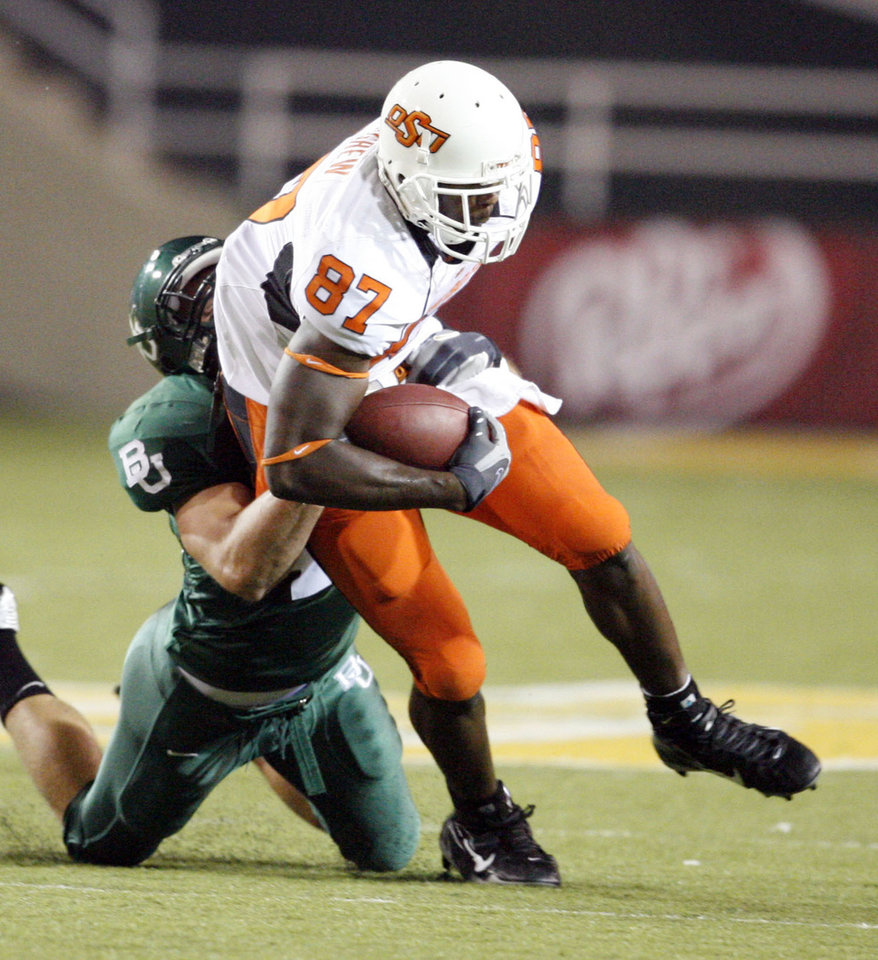 Photo - Brandon Pettigrew runs after a catch during first half action of the college football game between Oklahoma State University and Baylor University at Floyd Casey Stadium in Waco, Texas, Saturday, Nov. 17, 2007. BY STEVE SISNEY, THE OKLAHOMAN