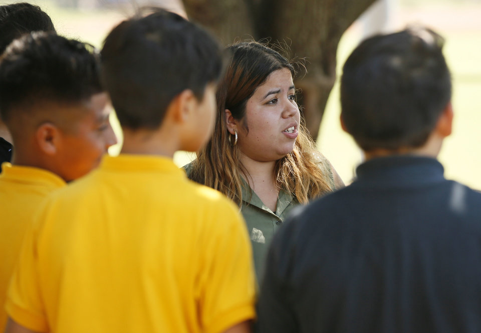 Photo - Brisa Ledezma, a sixth-grade social studies teacher, talks to her students at Santa Fe South, 4701 S. Shields Ave., in Oklahoma City, Thursday, Sept. 7, 2017. Ledezma is a DACA recipient. Photo by Nate Billings, The Oklahoman