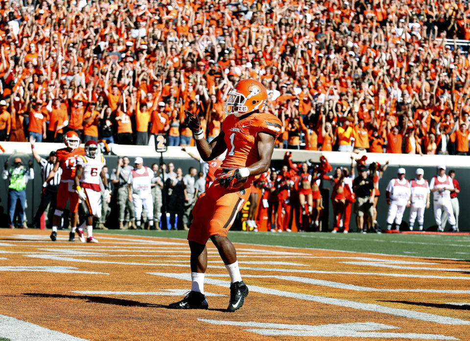 CELEBRATION: OSU's Joseph Randle celebrates a touchdown during a college football game between Oklahoma State University (OSU) and Iowa State University (ISU) at Boone Pickens Stadium in Stillwater, Okla., Saturday, Oct. 20, 2012. Photo by Sarah Phipps, The Oklahoman