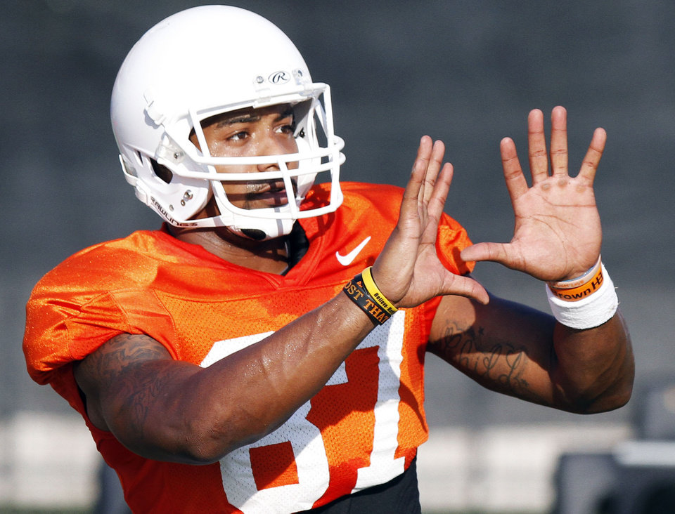 Photo - OKLAHOMA STATE UNIVERSITY / OSU / COLLEGE FOOTBALL: Oklahoma State wide receiver Tracy Moore catches a pass during the first full pad practice of the fall on August 6, 2013. Photo by KT King/ for The Oklahoman