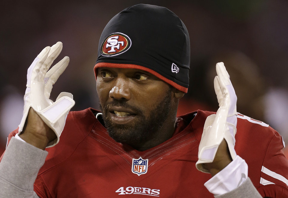 Photo -   San Francisco 49ers wide receiver Randy Moss stands on the sideline during the second half of an NFL preseason football game against the San Diego Chargers in San Francisco, Thursday, Aug. 30, 2012. (AP Photo/Marcio Jose Sanchez)