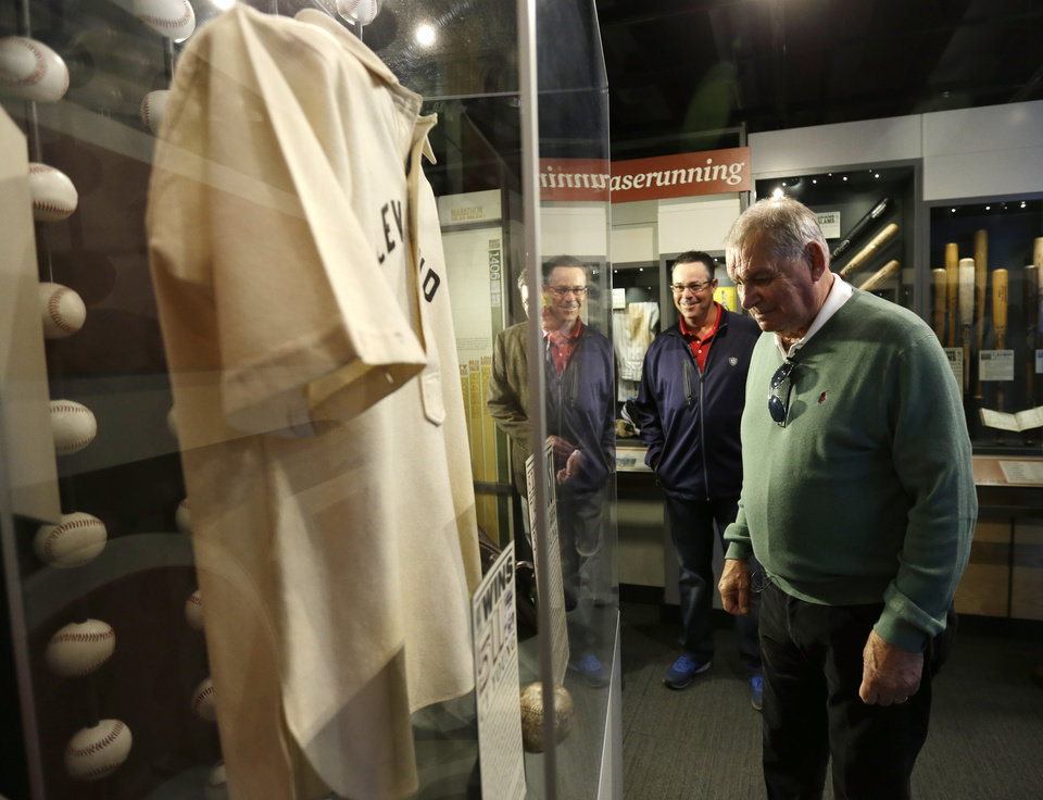 Photo - Former Atlanta Braves manager Bobby Cox, right, and former pitcher Greg Maddux look at a Cy Young exhibit during their orientation visit at the Baseball Hall of Fame on Monday, March 24, 2014, in Cooperstown, N.Y. They will be inducted to the hall in July. (AP Photo/Mike Groll)