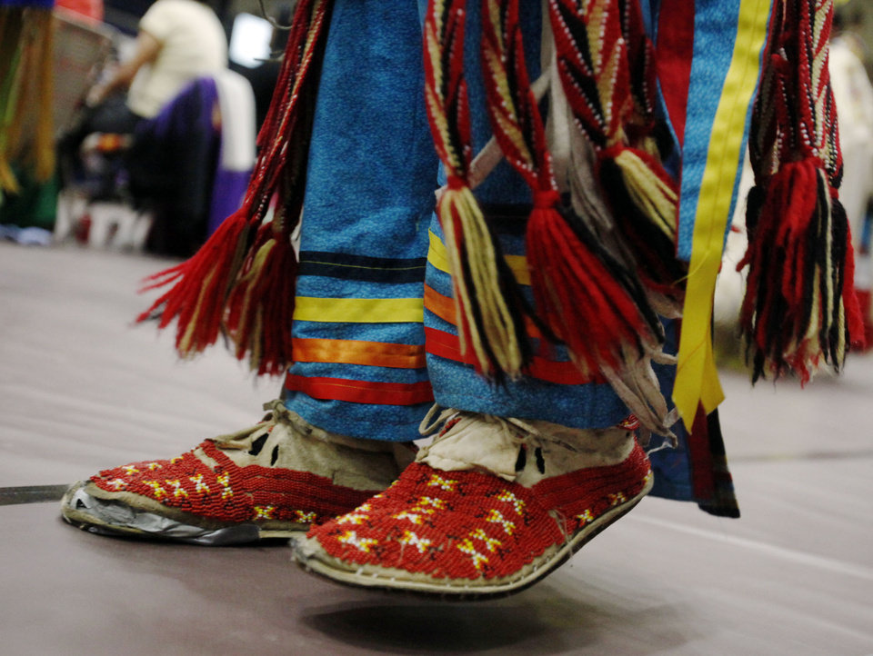 Photo -  Decorative moccasins of a dancer who participated in the grand entrance are shown at the University of Central Oklahoma's annual Spring Powwow held in Edmond. PHOTO BY K.T. KING, THE OKLAHOMAN   KT King -