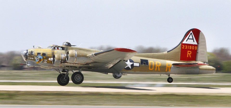 A B-17 Flying Fortress lands at Wiley Post Airport in Oklahoma City , Friday April 5, 2013.The Wings of Freedom National Tour will be on display all weekend at Wiley Post Airport. Photo By Steve Gooch, The Oklahoman