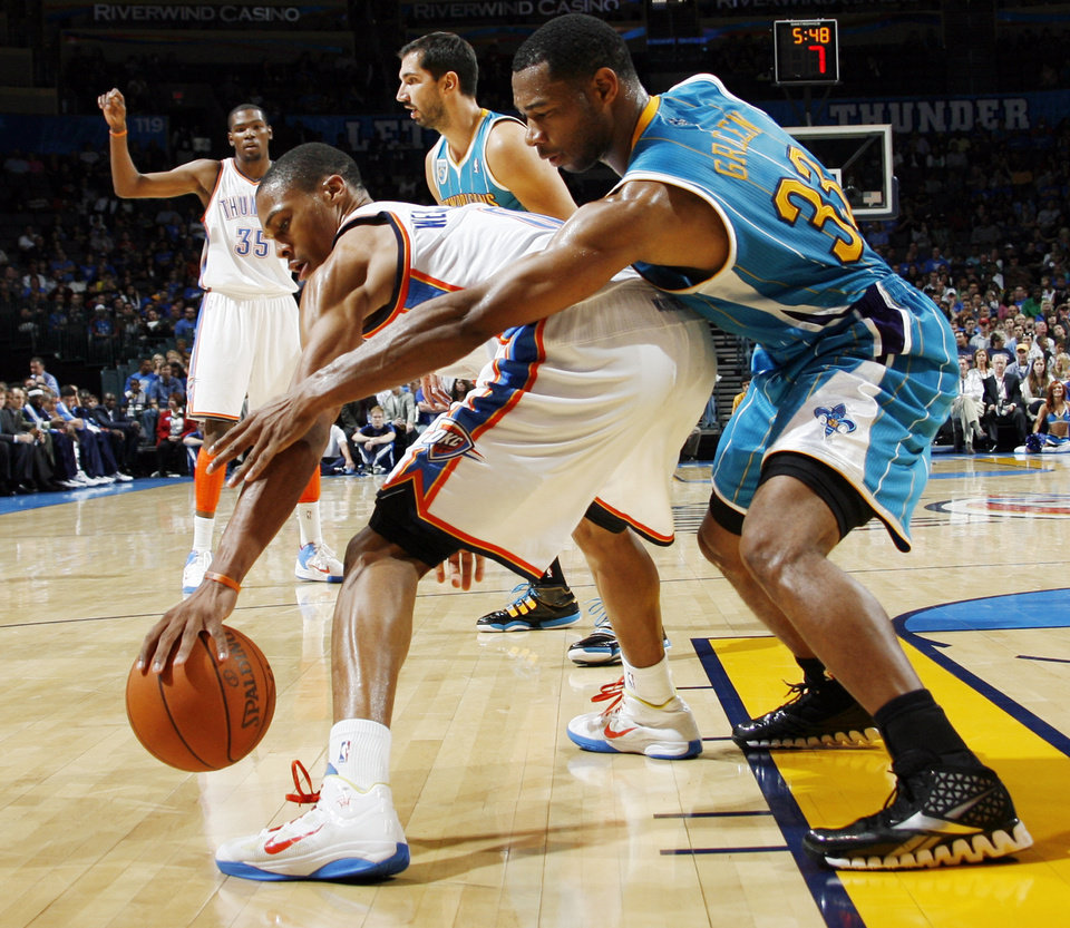 Photo - Willie Green (33) of New Orleans tries to steal the ball from Oklahoma City's Russell Westbrook (0) in front of Kevin Durant (35) of Oklahoma City and Peja Stojakovic (16) of New Orleans during the preseason NBA basketball game between the New Orleans Hornets and the Oklahoma City Thunder at the Ford Center in Oklahoma City, Thursday, October 21, 2010. The Thunder won, 101-86. Photo by Nate Billings, The Oklahoman