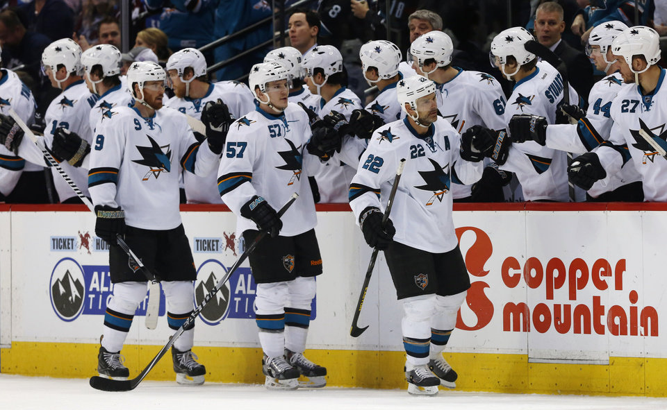 Photo - San Jose Sharks defenseman Dan Boyle, front right, is congratulated after scoring a goal as teammates Marty Havlat, of the Czech Republic, front left, and Tommy Wingels follow past the team box while facing the Colorado Avalanche in the second period of an NHL hockey game in Denver on Saturday, March 29, 2014. (AP Photo/David Zalubowski)