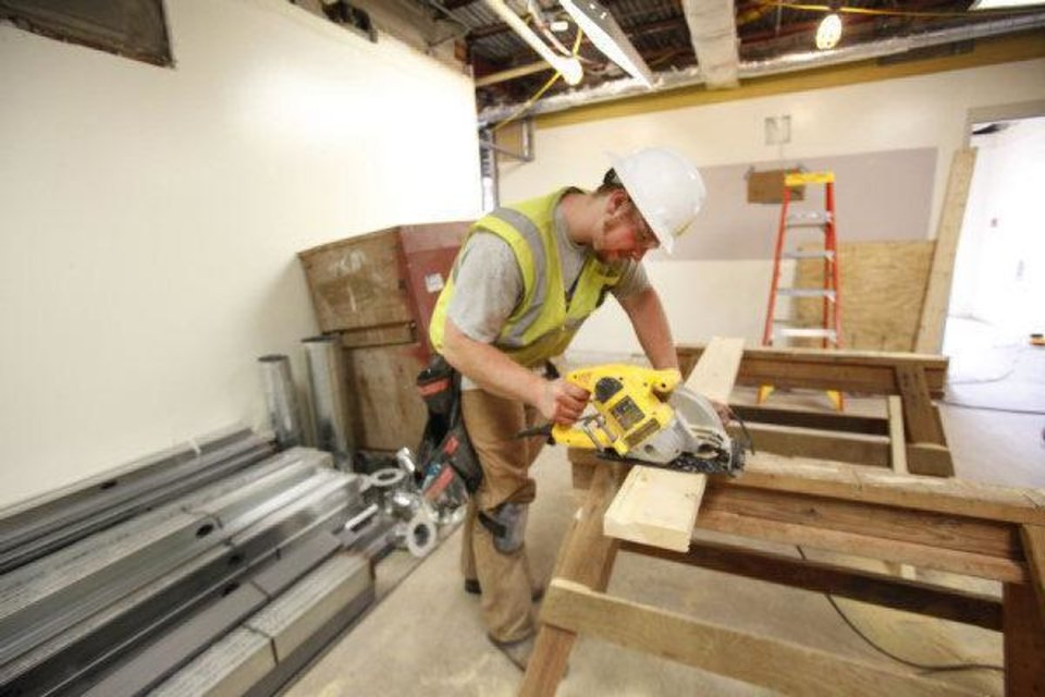 John McCampbell cuts a board in Oklahoma Christian University's Honors House, which will open this fall to honors students. PHOTO BY STEVE GOOCH, THE OKLAHOMAN <strong>Steve Gooch</strong>