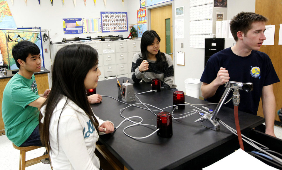 From left to right, science bowl team members Julia Zhu, Brandon Wong, Jane Hsi and Jacob Rowe answer questions at Edmond Santa Fe High School in Edmond, Okla., Tuesday, March, 6, 2012. Photo by Sarah Phipps, The Oklahoman