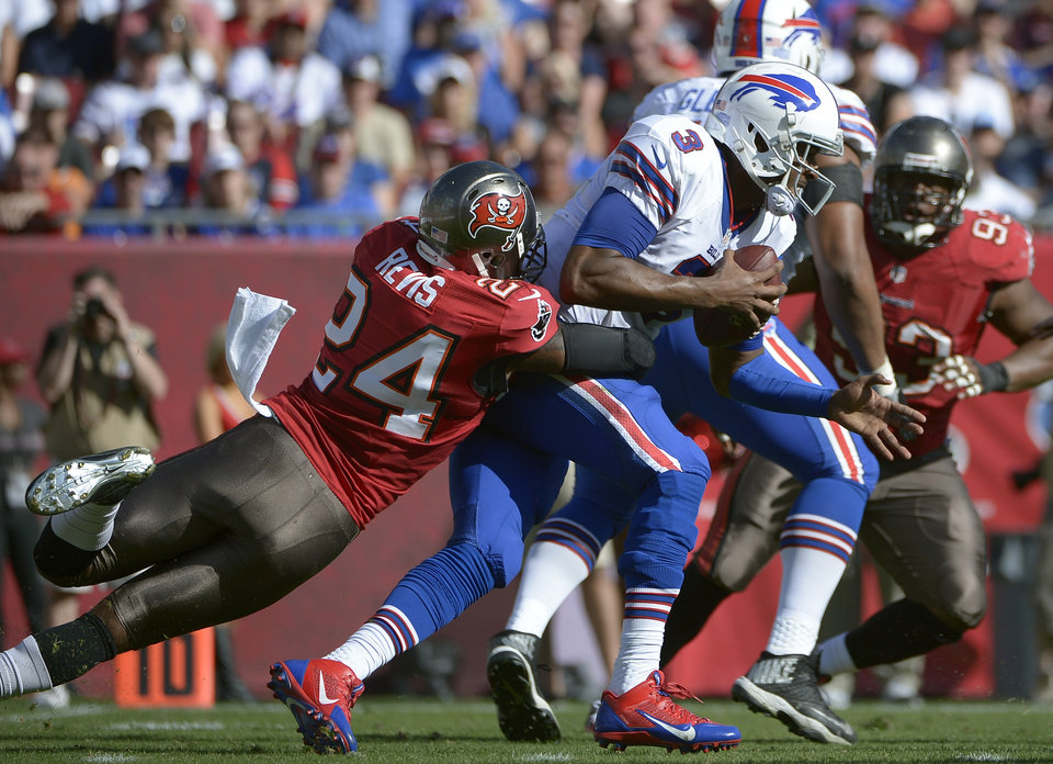 Photo - FILE - In this Dec. 8, 2013 file photo, Buffalo Bills quarterback EJ Manuel (3) is sacked by Tampa Bay Buccaneers cornerback Darrelle Revis (24) during the second quarter of an NFL football game in Tampa, Fla. As Day 2 of the NFL's free-agency period began to unfold, Carolina Panthers receiver Steve Smith and Tampa Bay Buccaneers cornerback Darrelle Revis were waiting to find out whether they might be traded or released. (AP Photo/Phelan M. Ebenhack, File)