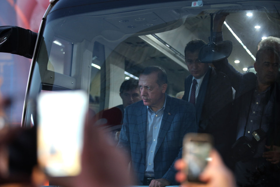 Photo - Prime Minister Recep Tayyip Erdogan, who is the front-runner in Turkey's presidential election, stands inside a bus in downtown Istanbul, Turkey, Sunday, Aug. 10, 2014. Turks were voting in their first direct presidential election Sunday _ a watershed event in Turkey's 91-year history, where the president was previously elected by Parliament. Prime Minister RecepTayyip Erdogan, who has dominated the country's politics for the past decade, is the strong front-runner to replace the incumbent, Abdullah Gul, for a five-year term. (AP Photo/Emrah Gurel)
