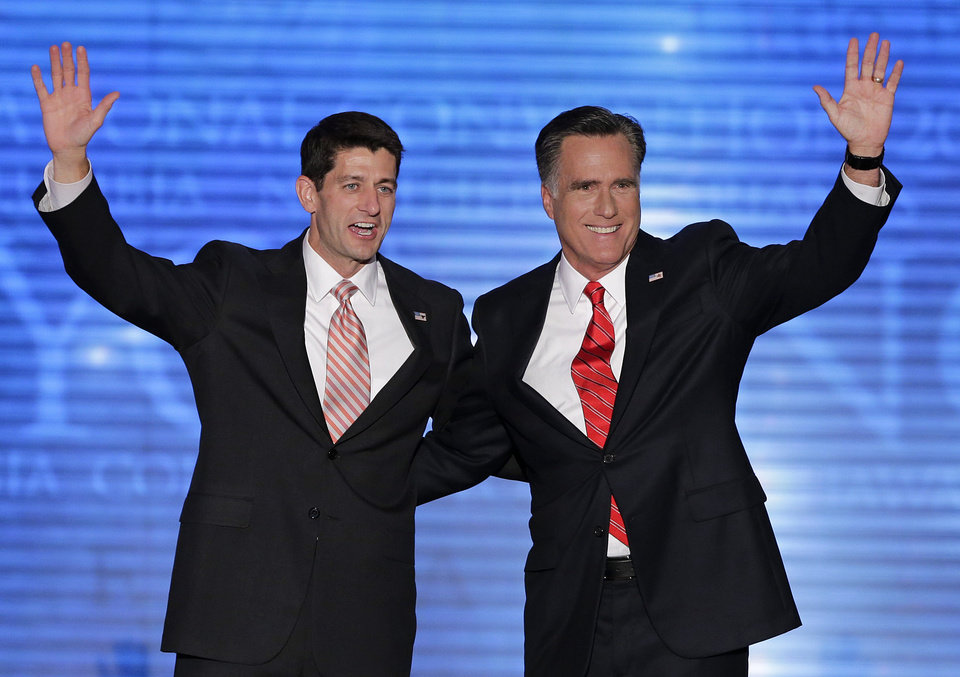 Photo -   Republican presidential nominee Mitt Romney and vice presidential nominee, Rep. Paul Ryan, left, wave to delegates during the Republican National Convention in Tampa, Fla., on Thursday, Aug. 30, 2012. (AP Photo/J. Scott Applewhite)