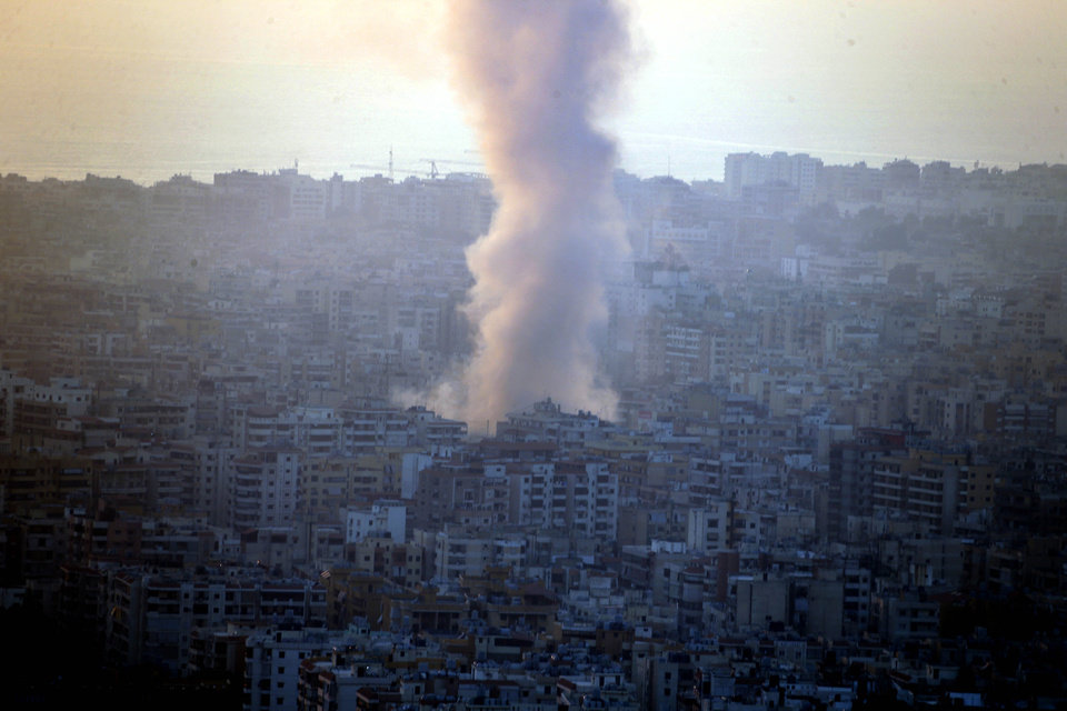 Photo - Smoke seen from Mount Lebanon rises from the site of a car bomb explosion in southern Beirut, Lebanon, Thursday, Aug. 15, 2013. The powerful car bomb ripped through a crowded southern Beirut neighborhood that is a stronghold of the militant group Hezbollah on Thursday, killing at least a dozen people and trapping dozens of others in burning cars and buildings in the latest apparent violence linked to the civil war in neighboring Syria, officials said. (AP Photo/Ahmad Omar)