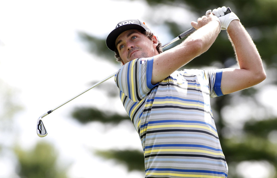 Photo - Keegan Bradley hits off the tenth tee during the first round of the Deutsche Bank Championship golf tournament in Norton, Mass., Friday, Aug. 29, 2014. (AP Photo/Stew Milne)