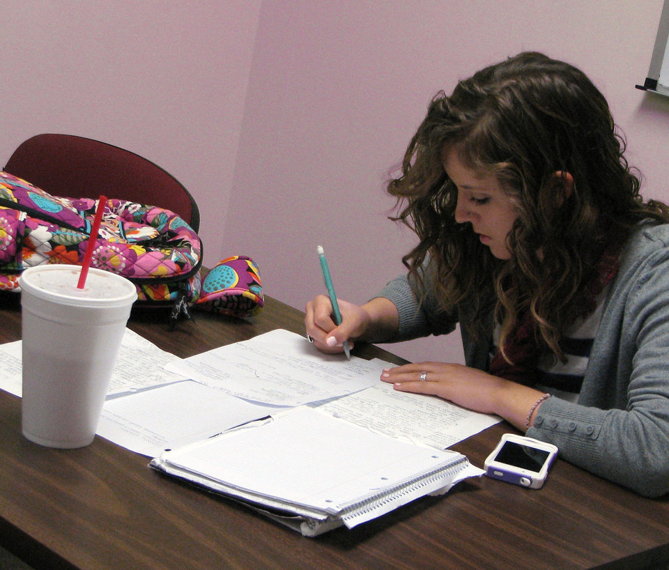 Photo - Sophomore Kayla Cernosek studies in the Mabee Learning Center at   Oklahoma Baptist University in Shawnee on Friday. Photo by Vallery Brown, The Oklahoman  Vallery Brown - THE OKLAHOMAN