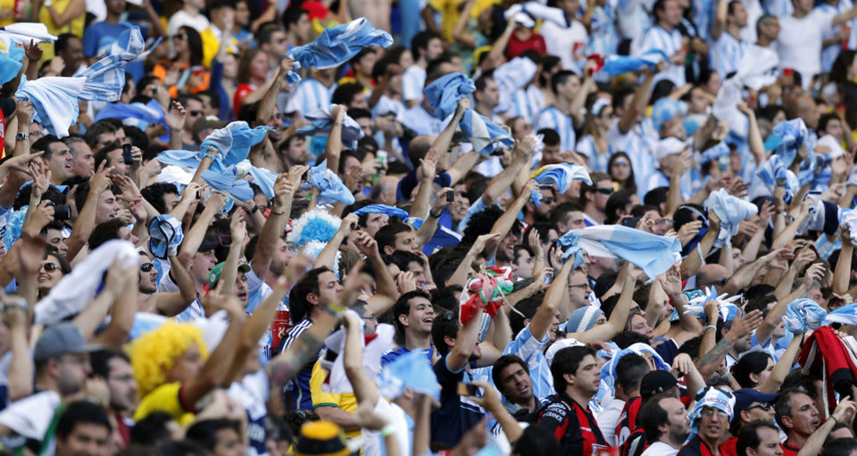 Photo - Argentina supporters cheer during the group F World Cup soccer match between Argentina and Iran at the Mineirao Stadium in Belo Horizonte, Brazil, Saturday, June 21, 2014. (AP Photo/Victor R. Caivano)