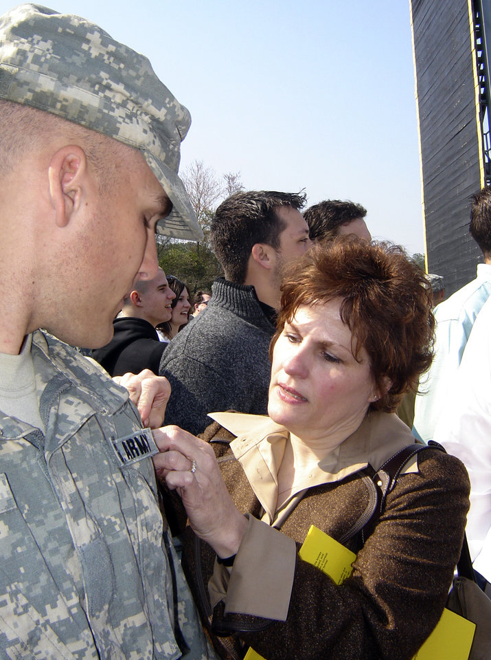 Vicki Behenna pins on Michael's Ranger tab in 2007.Photo provided by the Behenna Family