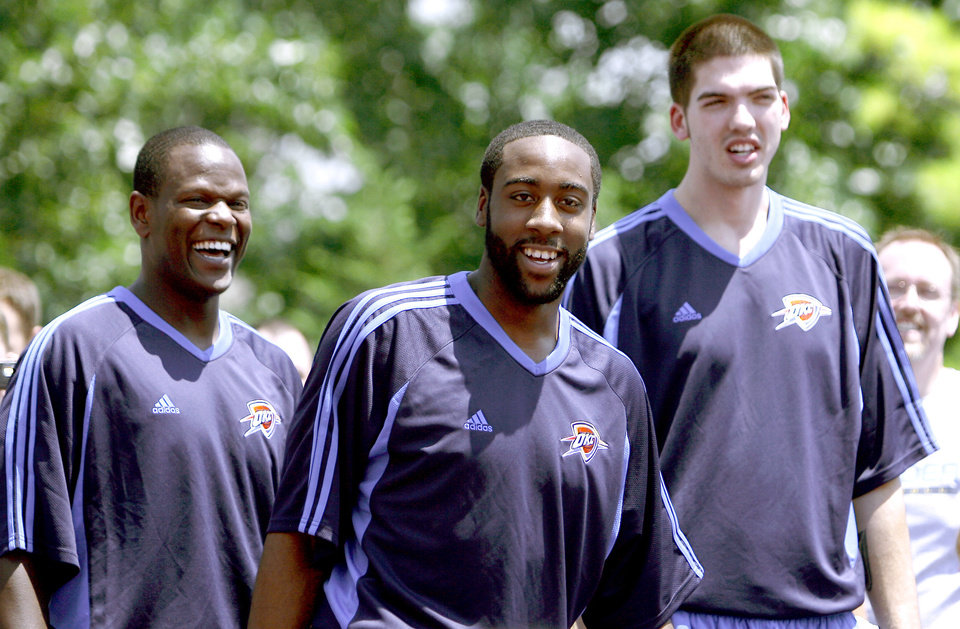 Photo - NBA BASKETBALL TEAM / DRAFT PICKS: Oklahoma City Thunder players Robert Vaden, James Harden and B.J Mullens laugh while they play basketball with Thunder Youth Basketball League at the Thunder Caravan at  Midfirst Bank, in Oklahoma City, Saturday, June 27, 2009. Photo by Sarah Phipps, The Oklahoman ORG XMIT: KOD