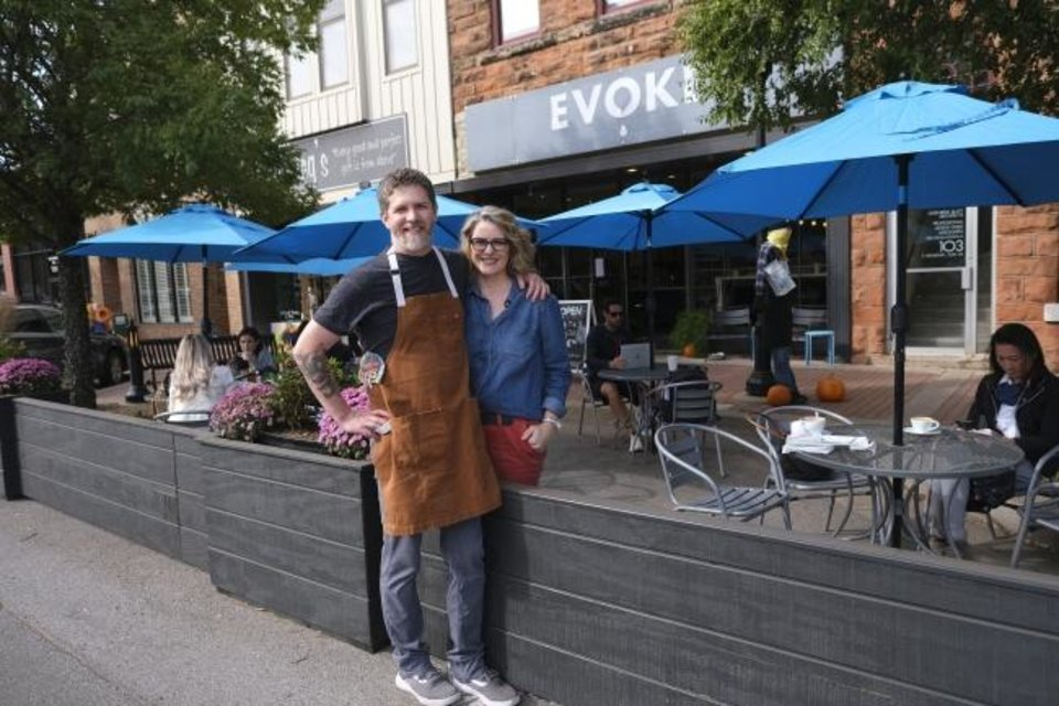 Photo - Robert and Lori Black, owners of Cafe Evoke. Streateries in downtown Edmond. Restaurants/cafes were allowed  to take over street space to expand their dining options during the pandemic. Thursday, October 15, 2020. [Doug Hoke/The Oklahoman]
