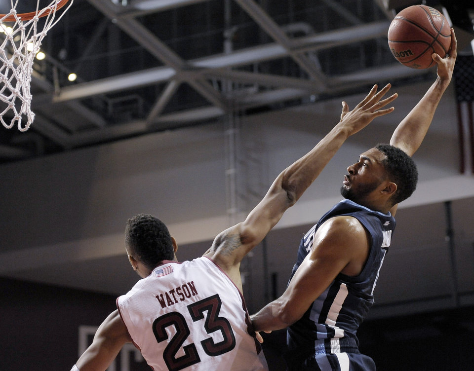 Photo - Temple's Devontae Watson (23) blocks a shot attempt from Villanova's Darrun Hillard during the first half of an NCAA college basketball game on Saturday, Feb. 1, 2014, in Philadelphia. (AP Photo/Michael Perez)