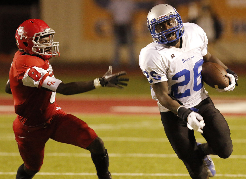 Photo - GHS #26 Donovan Jordan turns the corner past CA #8 Tre Bruner during the high school football game between Guthrie at Carl Albert in Midwest City, Friday, October 11, 2013.  Photo by Doug Hoke, The Oklahoman
