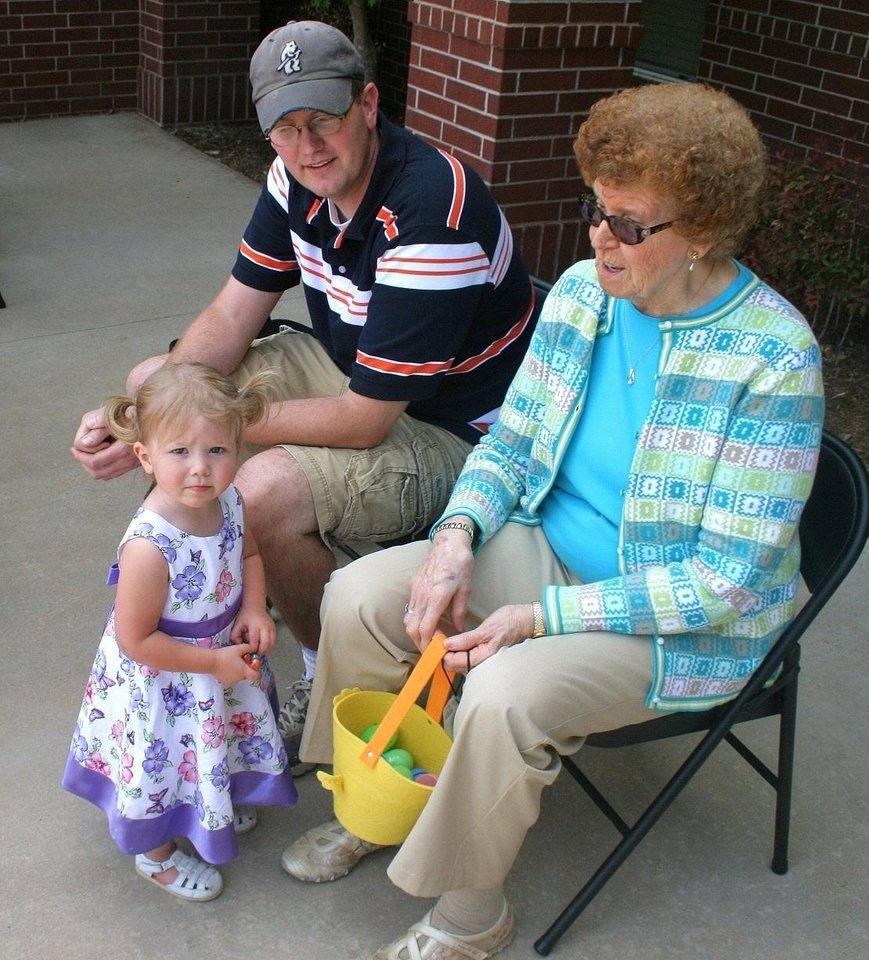 Charlotte Buchan, a Touchmark resident, enjoys her grandchild Brynn McDowell and the child\'s dad, Brian McDowell. Touchmark at Coffee Creek co-hosted an Easter egg hunt Saturday (April 16) with the Coffee Creek Homeowners Association. The Touchmark reside