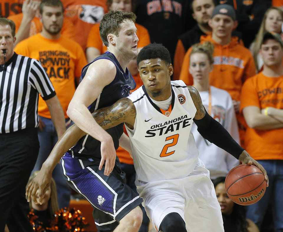 Photo - Oklahoma State's Le'Bryan Nash (2) tries to get past TCU's Hudson Price (21) during an NCAA college basketball game between Oklahoma State University (OSU) and TCU at Gallagher-Iba Arena in Stillwater, Okla., Wednesday, Jan. 15, 2014.  Photo by Bryan Terry, The Oklahoman