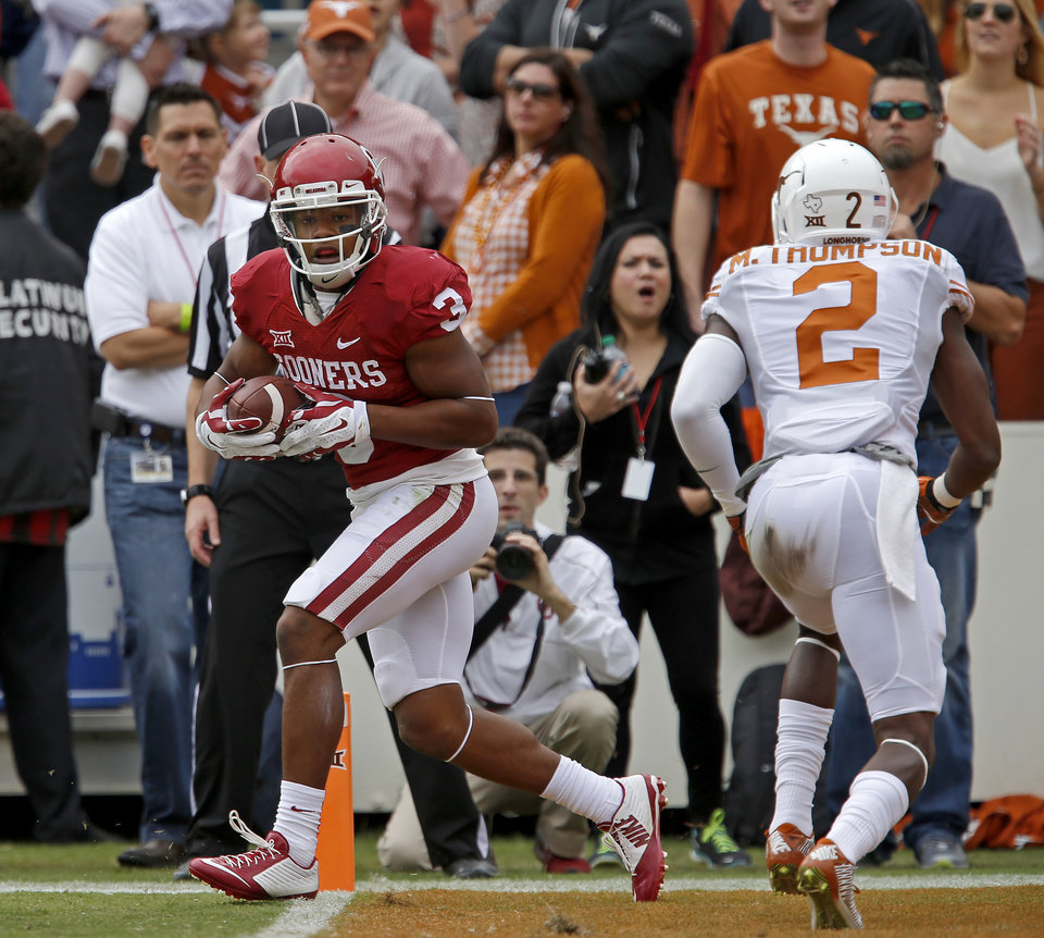 Photo - Oklahoma's Sterling Shepard (3) scores a touchdown in front of Texas' Mykkele Thompson (2) during the Red River Showdown college football game between the University of Oklahoma Sooners (OU) and the University of Texas Longhorns (UT) at the Cotton Bowl in Dallas on Saturday, Oct. 11, 2014. 