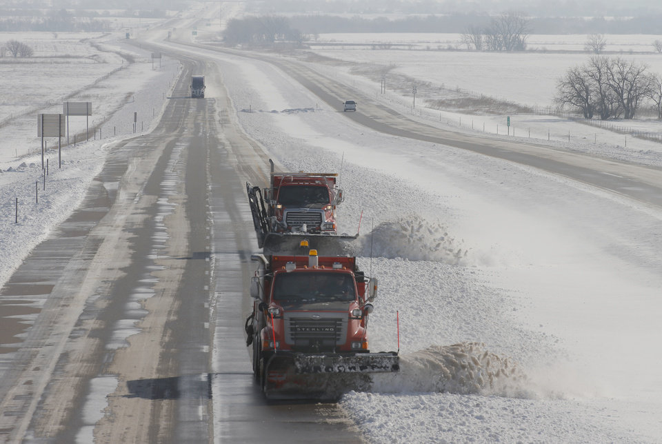 Photo - A pair of snow plows head west on US-54 Highway, clearing the snow off the roadway, near Cheney, Kan., Tuesday, Feb. 26, 2013. The second major snowstorm in a week battered the nation's midsection Tuesday, dropping a half-foot or more of snow across Missouri and Kansas and cutting power to thousands.  Gusting winds blew drifts more than 2 feet high and created treacherous driving conditions for those who dared the morning commute.  (AP Photo/The Wichita Eagle, Bo Rader)