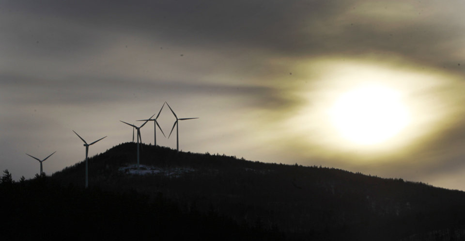 Photo - In this photo taken Tuesday Jan. 28, 2014 wind turbines are seen as the sun sets in Rumney, N.H. On Wednesday Jan. 29, 2014 New Hampshire lawmakers defeated a temporary ban on new wind turbines and electric transmission line projects. (AP Photo/Jim Cole)