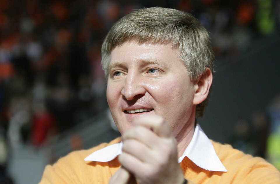 Photo - FILE - In this Wednesday, May 5, 2010 file photo, Shakhtar Donetsk's billionaire owner Rinat Akhmetov celebrates after winning the Ukrainian Premier League soccer match against Dynamo Kiev at Donbass-Arena stadium in Donetsk, Ukraine. Six South Americans - five Brazilians and one Argentine - have refused to return to Ukraine to play for their football club in Donetsk as conflict rages around the city, risking possible fines and suspensions for breach of contract. (AP Photo/Andrey Lukatsky)
