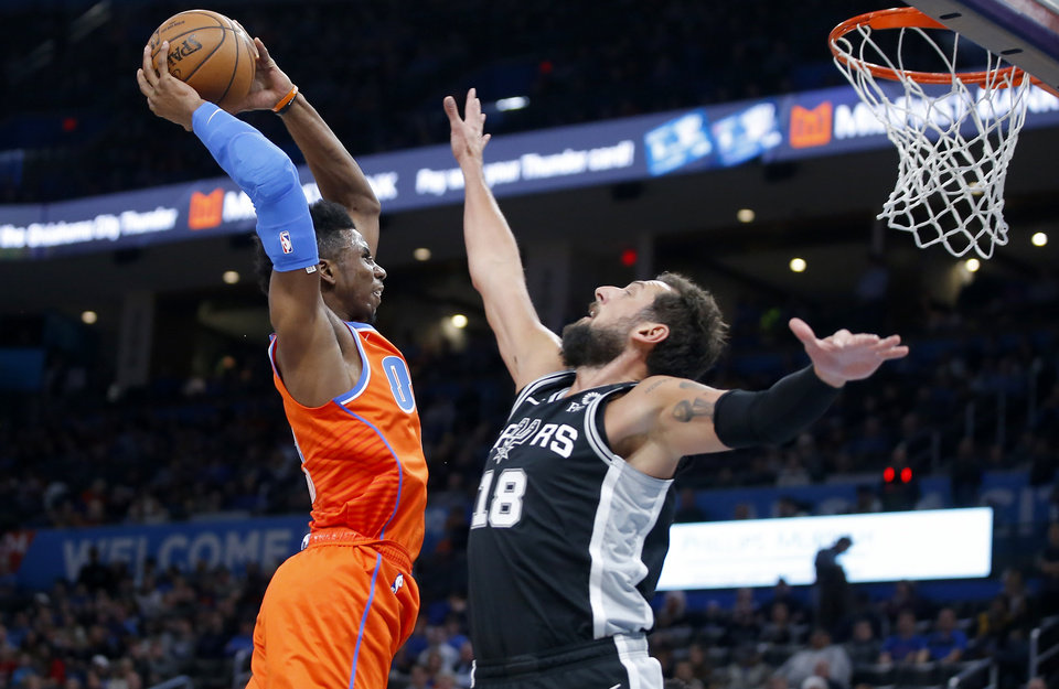 Photo - Oklahoma City's Hamidou Diallo (6) goes up for a dunk beside San Antonio's Marco Belinelli (18) during an NBA basketball game between the Oklahoma City Thunder and the San Antonio Spurs at Chesapeake Energy Arena in Oklahoma City, Sunday, Feb. 23, 2020. Oklahoma city won 131-103. [Bryan Terry/The Oklahoman]