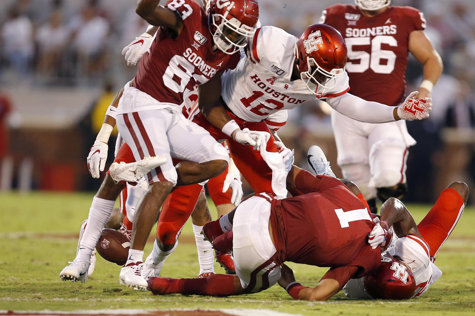 Photo - Oklahoma's Jalen Hurts (1) fumbles the ball during a college football game between the University of Oklahoma Sooners (OU) and the Houston Cougars at Gaylord Family-Oklahoma Memorial Stadium in Norman, Okla., Sunday, Sept. 1, 2019. [Bryan Terry/The Oklahoman]