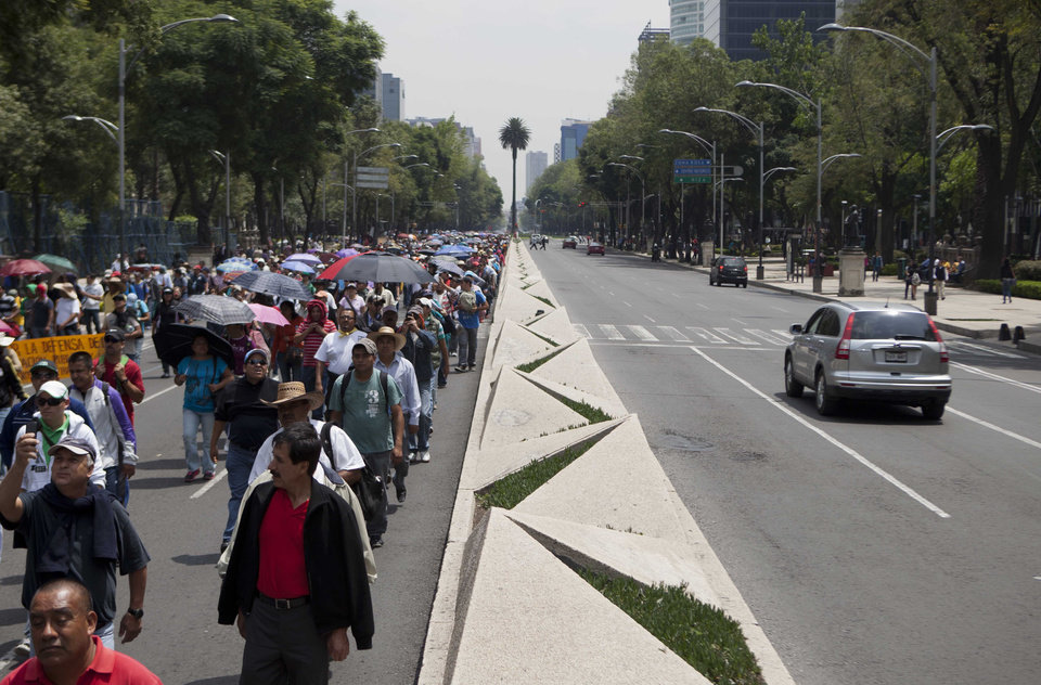Public school teachers march Wednesday to Los Pinos presidential residence as they block vehicular access to Paseo de la Reforma, a main artery in Mexico City. AP Photo